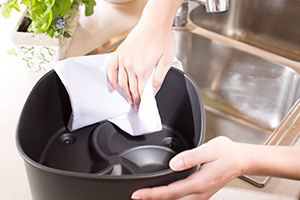 rub airfryer surfaces of both pan and basket with paper towels